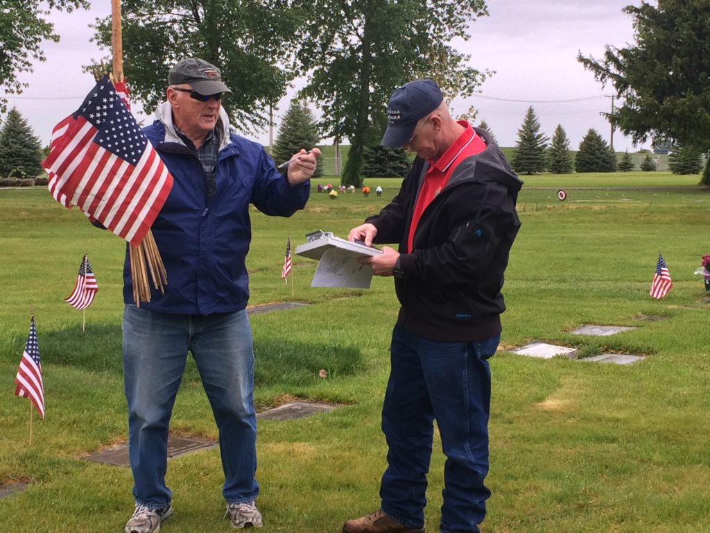 Darrel Homer, Post Commander of the American Legion Post 56 in Idaho Falls, looks at the list of unmarked graves and searches for the veterans row by row. | Sydney Jensen, KID NEWSRADIO