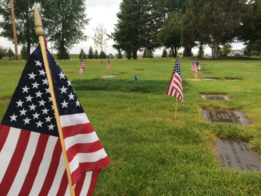 Flags dot the graves at Fielding Memorial Cemetery in Idaho Falls. Decorating every veteran grave at the cemetery takes volunteers four hours | Sydney Jensen, KID NEWSRADIO
